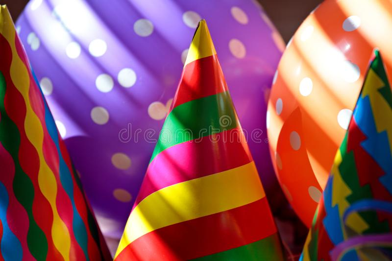 Balloons and paper hats for first of may stock photo