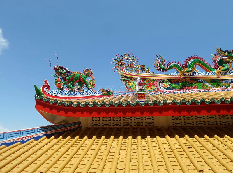 Colourful dragon on yellow roof of Chinese Temple on north harbor of Koh Sichang Island stock photography
