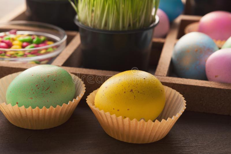Colourful easter eggs in paper mold stock photos