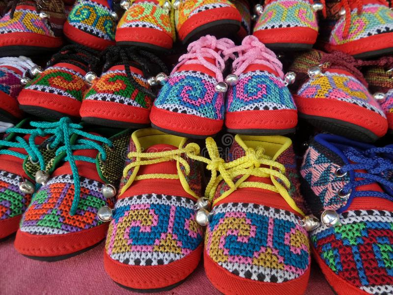 Colourful embroided children shoes. Hilltribe handmade product with native design stock photo