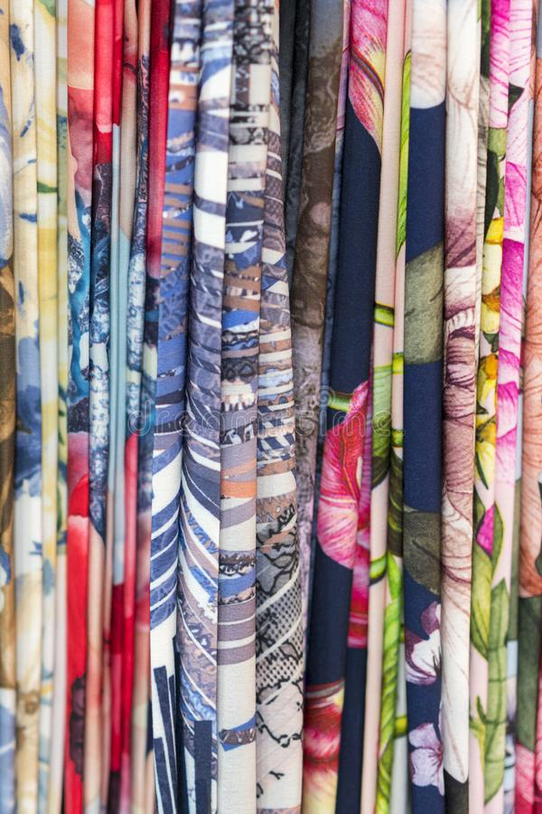 Colourful ethnic scarves in a medina location - close up and full frame. Multicolor fabric background. vertical photo.  stock photo