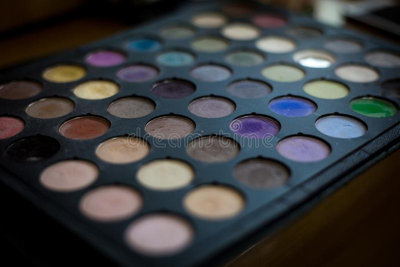 Colourful eye shadows palette Professional cosmetics for the creation of modern makeup. multi-colored eye shadow palette. Colourful eye shadows palette. Makeup stock image