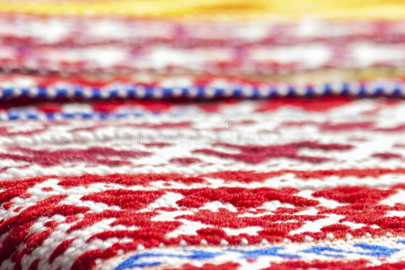 Colourful fabric with embroidered ornament. On a counter stock photos