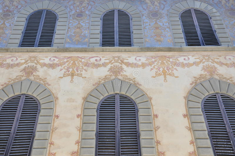 Colourful facade of the house. With closed shutters stock photography