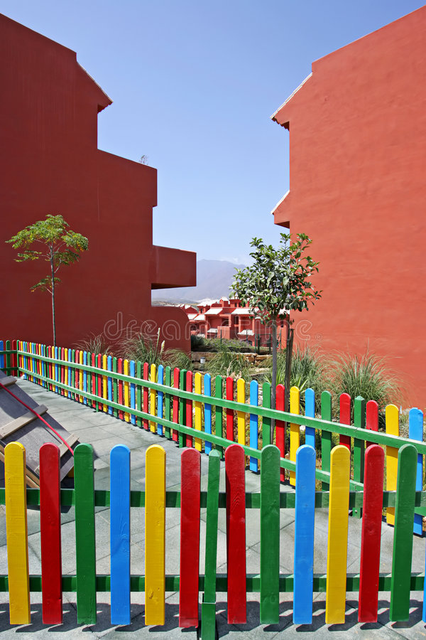 Colourful fence of childrens playground in Spanish vacation apartments royalty free stock images