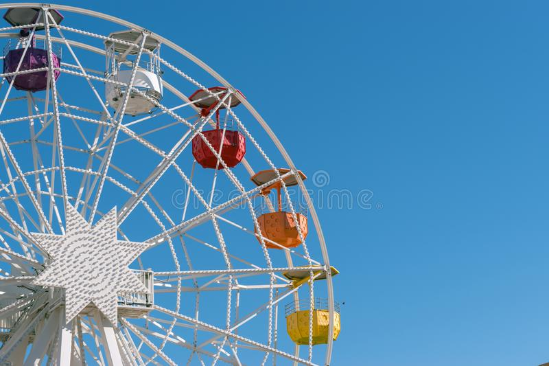 Colourful ferris wheel in the amusement park Tibidabo on background of blue sky, Barcelona, Spain.  stock images