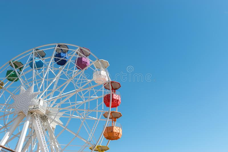 Colourful ferris wheel in the amusement park Tibidabo on background of blue sky, Barcelona, Spain.  stock photography