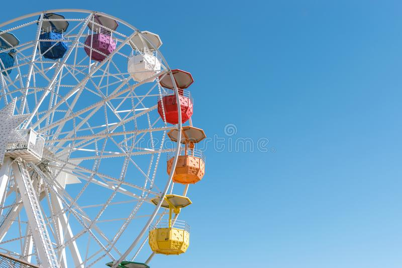 Colourful ferris wheel in the amusement park Tibidabo on background of blue sky, Barcelona, Spain.  royalty free stock photos
