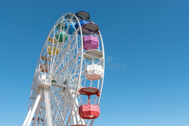 Colourful ferris wheel in the amusement park Tibidabo on background of blue sky, Barcelona, Spain.  stock image