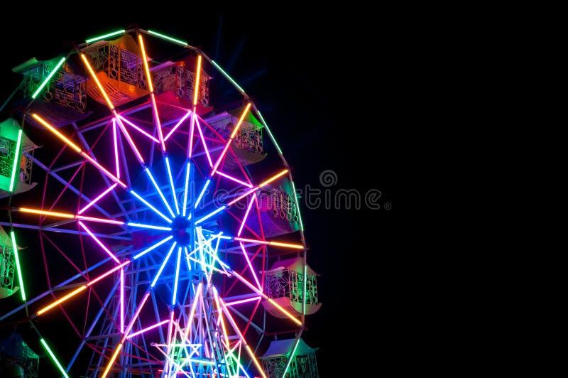 Colourful Ferris wheel on a beautiful night,Colourful Vintage Ferris wheel stock photos