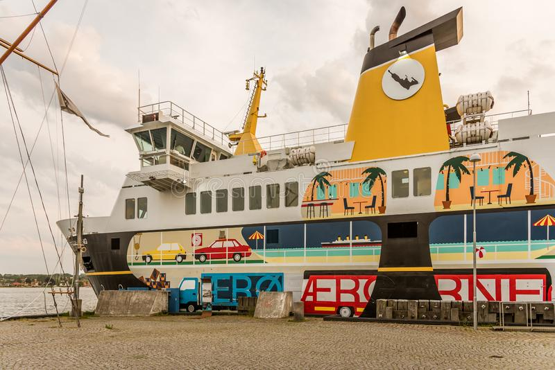 The colourful ferry to Aeroe at quay in the port of Svendborg. The colourful ferry to Aeroe at quayside in the harbour-terminal of Svendborg, Denmark, July 10 stock photos