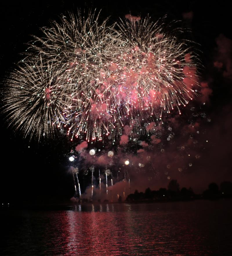 Colourful Fireworks Display. A colourful fireworks display at night stock photo