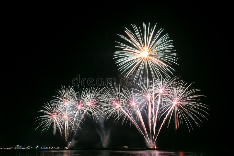 Colourful Fireworks. Multiple Fireworks in night sky in a composition in shades white royalty free stock images