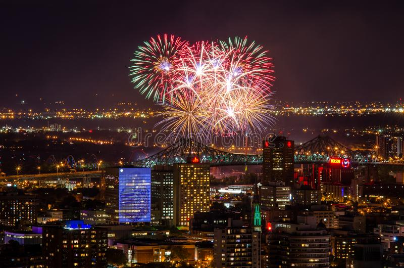 Colourful fireworks in the night sky over city royalty free stock photography