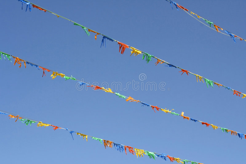 Colourful flags. In the sky royalty free stock images