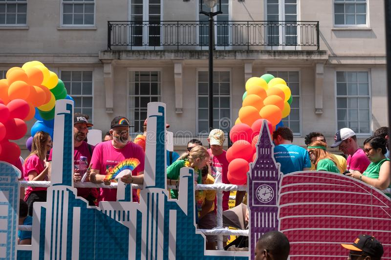 Colourful float with people on board and decorated with balloons, on Regent Street during the Gay Pride Parade 2018 in London. London UK, July 2018. Colourful royalty free stock photo