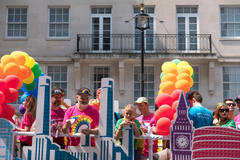 Colourful float with people on board and decorated with balloons, on Regent Street during the Gay Pride Parade 2018 in London. London UK, July 2018. Colourful stock photos