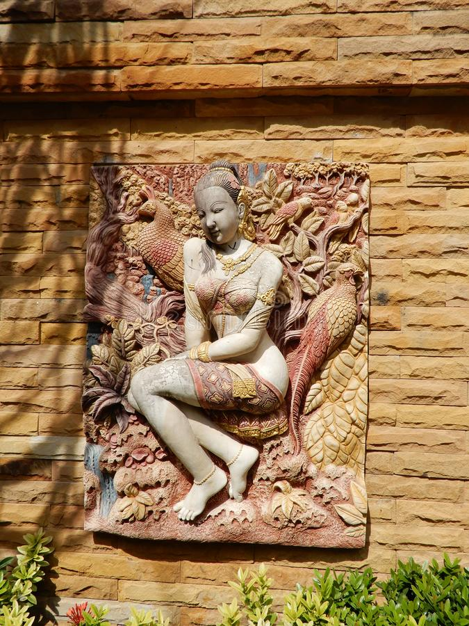 Colourful frieze. Skilfully created and crafted Bas-relief artwork set into a wall here in Pattaya, Thailand stock photos
