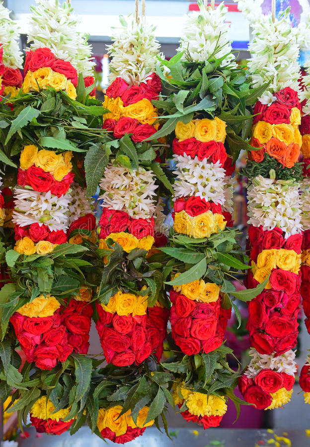 Colourful garland hanged and sold in an India stall nearby a temple. Colourful garland hanged and sold in an India stall nearby a Hindu temple in Singapore royalty free stock images