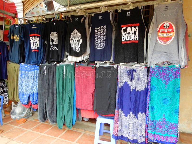 Colourful garments. Colourful clothes on display and for sale in a shop here in Siem Reap, Cambodia stock photo