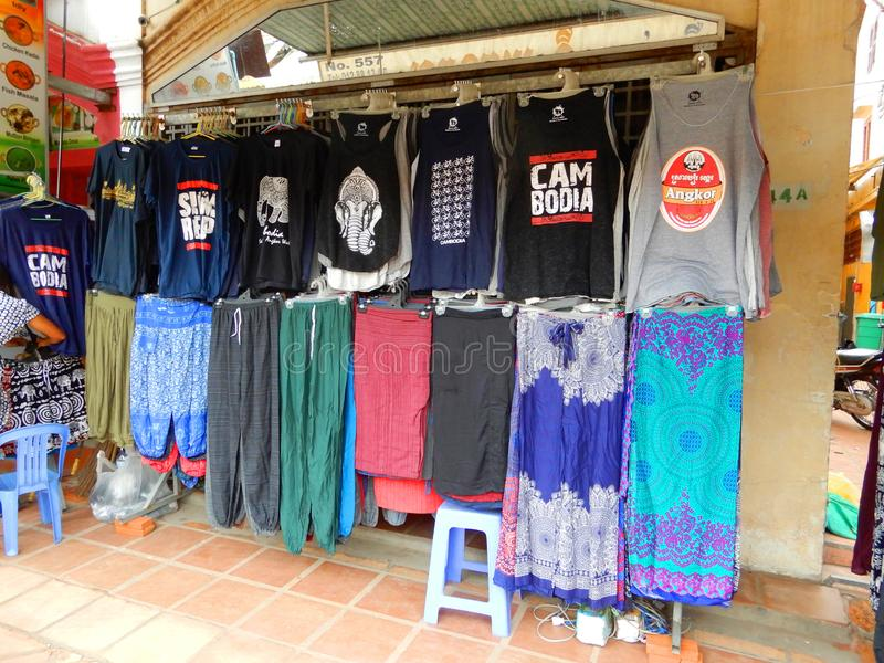 Colourful garments. Colourful clothes on display and for sale in a shop here in Siem Reap, Cambodia royalty free stock image