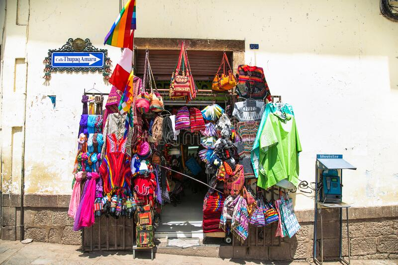 Colourful goods for sale in a souvenir shop in the historic city of Cusco in Peru royalty free stock photo