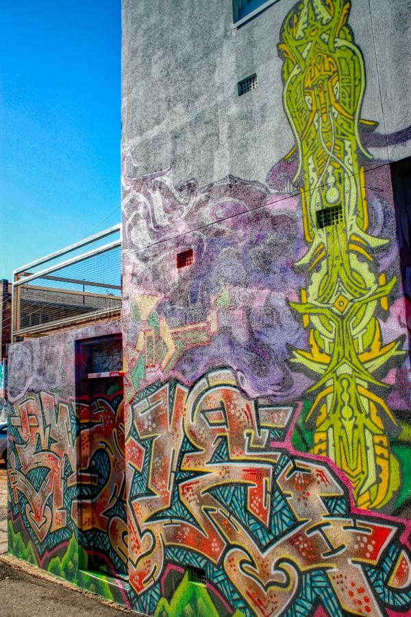Colourful graffiti mural on the side of the wall stock photo