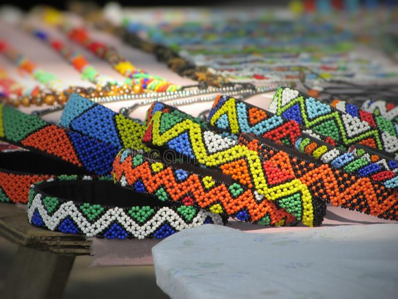 Colourful hand crafted Zulu Jewellery in Durban South Africa. Multicolored Zulu crafted beads on table in Durban South Africa royalty free stock photos