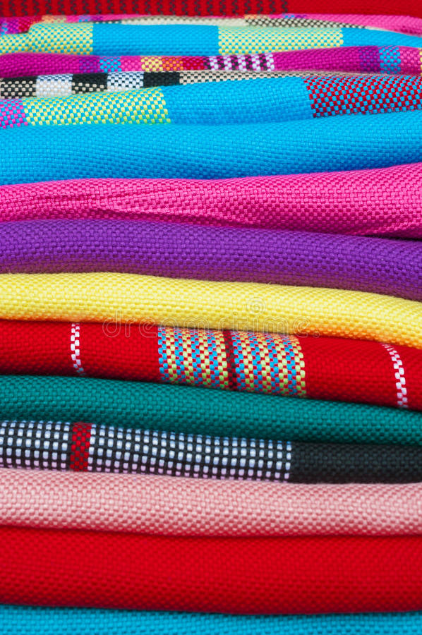 Colourful handmade scarfs close-up. FENGHUANG, CHINA - Miao-style scarves on sale in Fenghuang ancient town, Hunan Province, China royalty free stock image