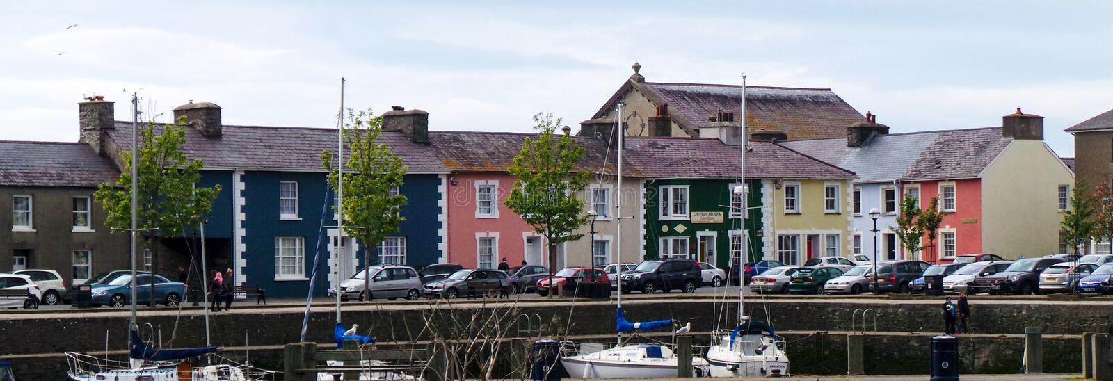 Colourful harbour houses. Aberaeron, United Kingdom - May 29 2013:   Colourful houses line the harrbour front off Market Street stock images