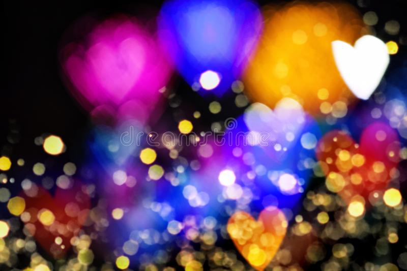 Colourfull heart bokeh background. Colourful heart bokeh festive glitter background. Christmas and Valentine's day greeting cards, invitations, flyers royalty free stock image