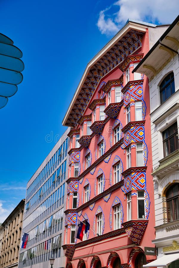 Colourful Historical Building, Ljubljana, Slovenia. A colourful red facade multi level historical building in Ljubljana, Slovenia, Eastern Europe, with Slovenian stock image