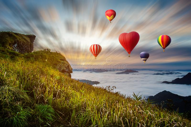 Colourful hot-air balloons flying over the mountain. At Phucheefa,Chiangrai province ,North of Thailand stock photos