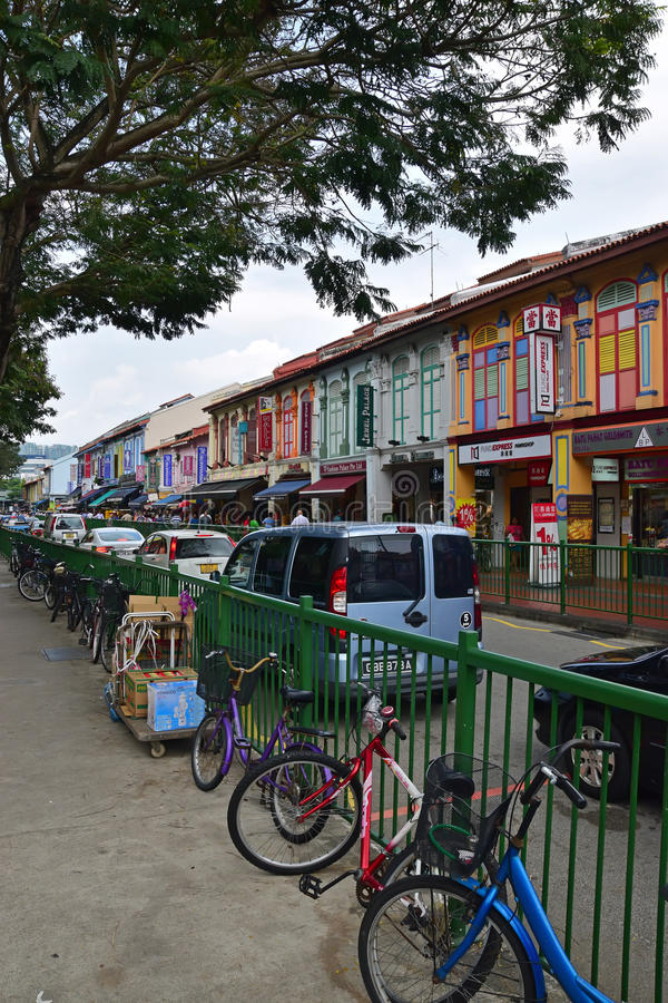Colourful houses along Serangoon Road in Little India, Singapore. Colourful shophouses along Serangoon Road in Little India, Singapore with bicycles and cars royalty free stock photos