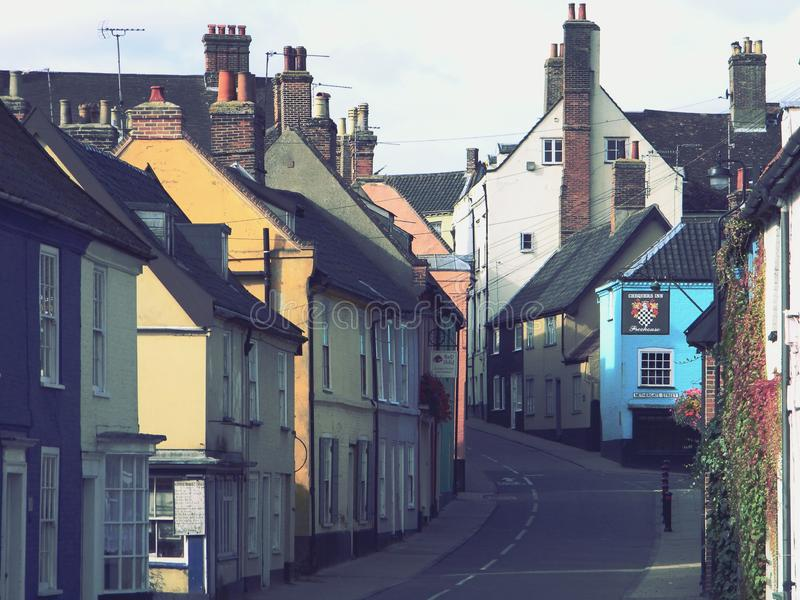 Bridge Street Bungay Suffolk United Kingdom. Colourful houses and shops Bridge Street Bungay Suffolk United Kingdom vintage filter royalty free stock photos