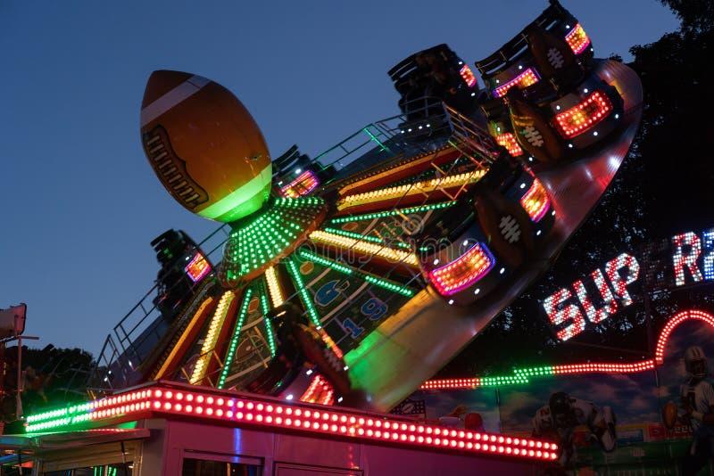 Illuminated Fairground Ride at Night. stock image