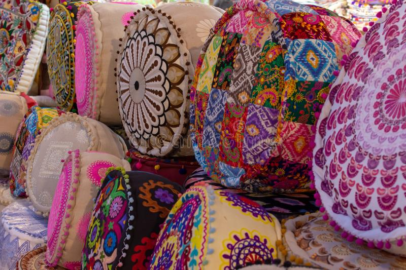 Colourful Indian Pillows lines up for sale in at Global Village Market in Dubai, United Arab Emirates. `Dubai, Dubai/UAE - 5/6/2019: Colourful Indian Pillows stock photography