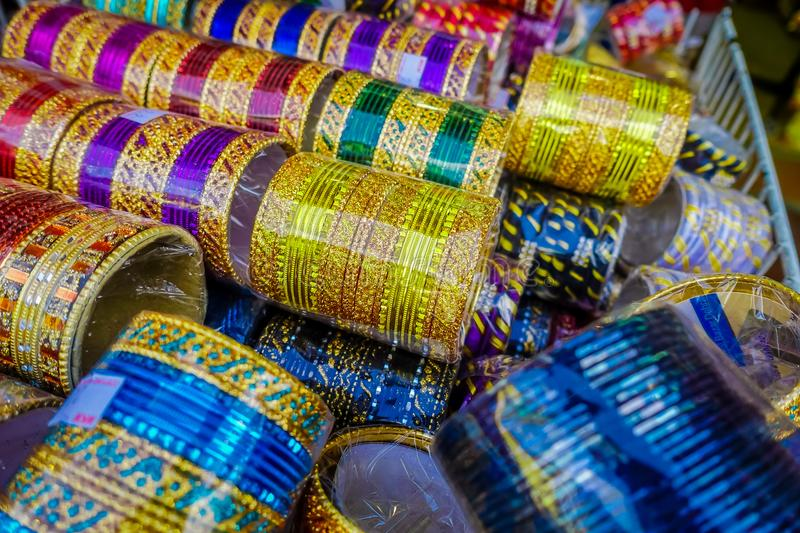 Colourful Indian wrist bracelets stacked in piles on display at a shop in Little India in Singapore. Colorful urban stock photo