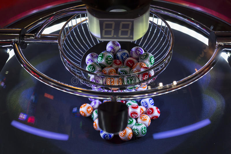 Colourful lottery balls in a lotto machine stock image