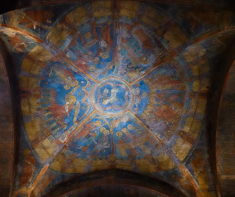 Colourful medieval painting on the ceiling of the main nave in Braunschweig Cathedral, with the peaceful sheep of Jesus in the royalty free stock images