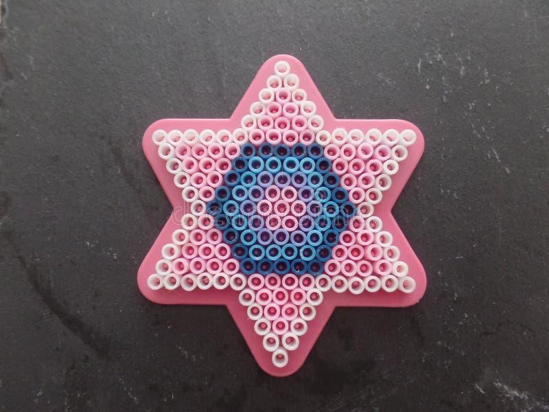 Colourful menchii, białego i błękitnego z paciorkami gwiazdowy kształt, obraz stock