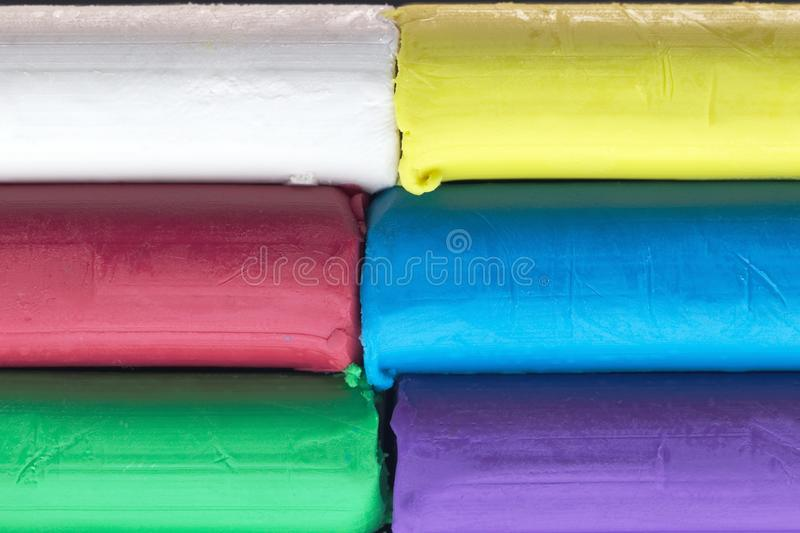 Colourful modelling clay, stack of colored dough stock photography