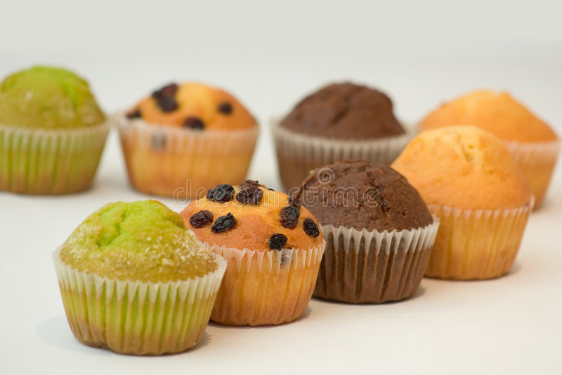 Colourful Muffins. Assorted colourful muffins stock image