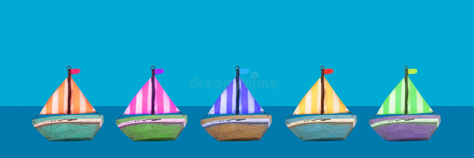 Colourful old wooden toy boats banner. Blue background stock image