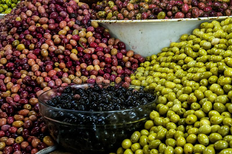 Colourful olives at the market royalty free stock photo