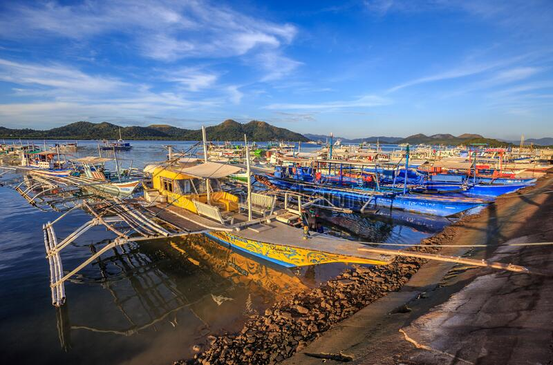 Colourful outrigger tour boats at Coron, Palawan. Outrigger tour boats at Lualhati Park, Coron Town. This is the place where all the day tours to the surrounding royalty free stock photo