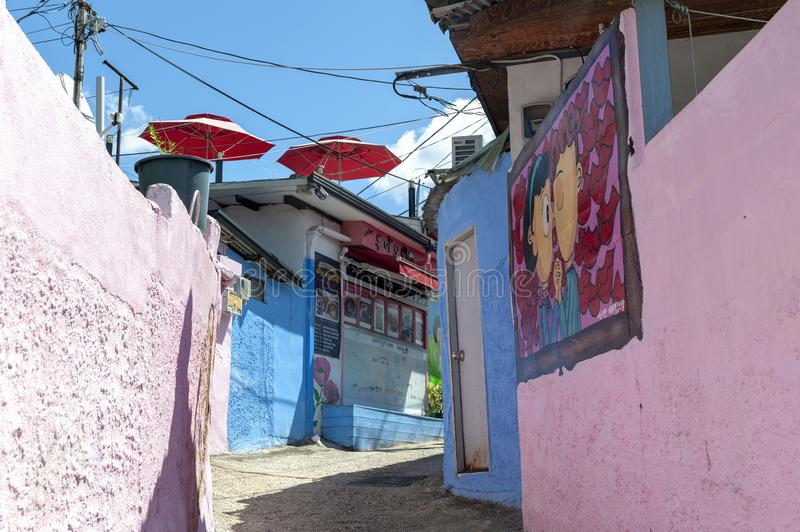 Colourful paintings and decorations on walls and buildings at Jaman Mural Village in Jeonju, South Korea stock photo