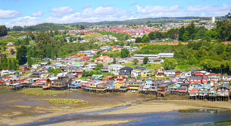Colourful Palafito houses on stilts in Castro, Chiloe Island, Patagonia, Chile. Blue sky stock photo