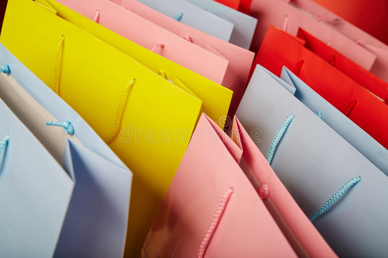Colourful paper shopping bags close up stock photo