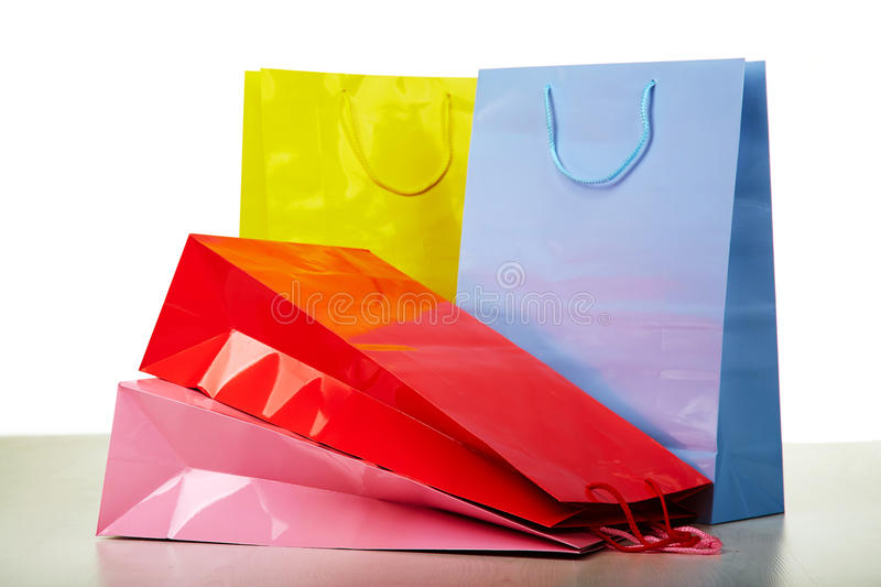 Colourful paper shopping bags on white royalty free stock photography